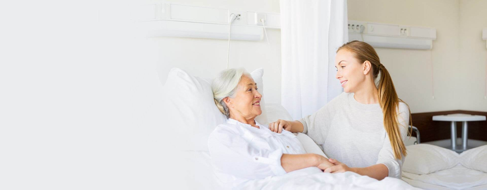 lady and patient smiling at each other